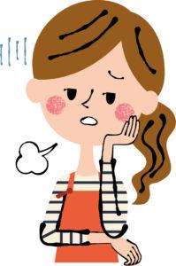 イライラして憂鬱そうな表情をしているエプロンをした女性のイラスト